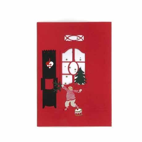Briefkarte Weihnachtsjunge am Ofen rot